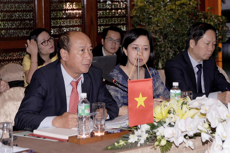 Việt Nam-Lào: Hợp tác triển khai chế độ bảo hiểm bắt buộc đối với chủ xe cơ giới quá cảnh qua biên giới
